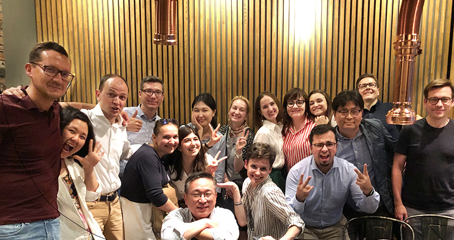 Jaewon Lee and all HCR employees are smiling for the camera at their team building dinner.