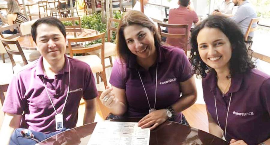 Workers of Banco Hyundai Capital Brasil, a joint venture between Hyundai Capital Services and Santander, poise for a photo in a purple-color T shirt at an event in Sao Paulo.